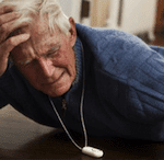 elderly man with fall alarm