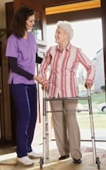 Elderly Woman with Walker Talking to Caregiver