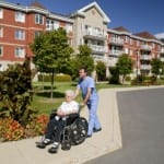 caregiver with elderly person in wheelchair