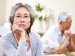 Anxious elderly woman showing early signs of dementia