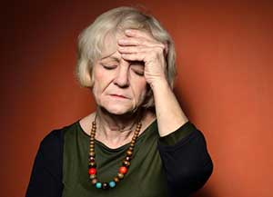 Elderly woman showing early signs of dementia