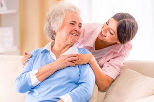 senior with Alzheimer's and her caregiver
