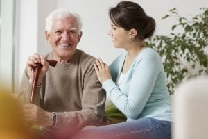 elderly man receiving in-home care services