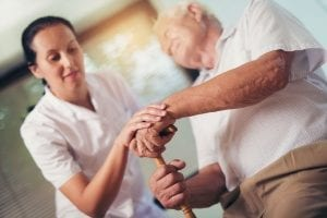 senior with hereditary Parkinson's disease receiving in-home care services