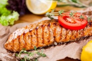 grilled salmon to be put on a sandwich made by an in-home care agency for seniors
