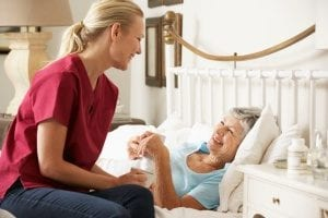 senior living in Rockville, MD receiving in-home care in her bedroom
