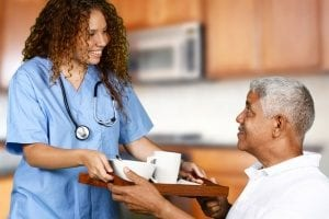senior receiving a lot of good nutrition from food made by an in-home care agency