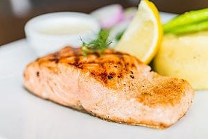 cooked salmon which a senior developing Alzheimers will eat since it is considered one of the best brain foods for the elderly