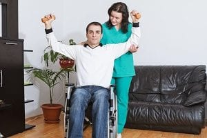 special needs in-home care provider helping individual receive the exercise they need