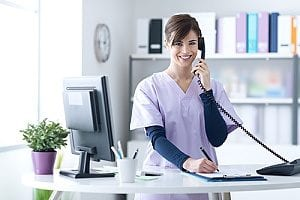 a receptionist of an in-home care agency answering the phone