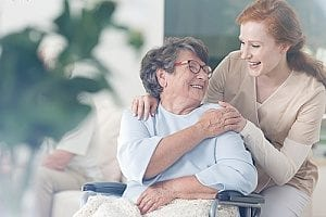 an Alzheimer's care giver working with a senior patient