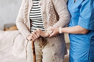 an elderly woman receiving emotional support from a nurse which is part of the nurses role in end of life care