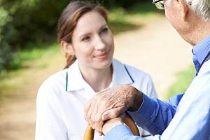 dementia caregiver communicating with elderly man