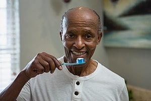 senior man receiving personal hygiene care