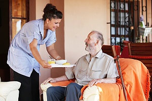elderly man learning what to expect from in-home care services