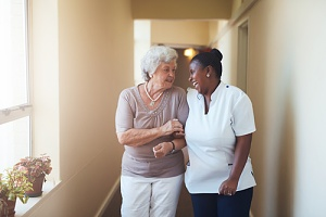 elder woman speaking with the right in home care agency