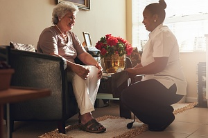 woman talking to a patient about in home respite care services