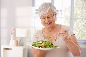 older woman eating the best diet for seniors happily