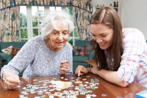 Girl and Grandma doing Puzzle