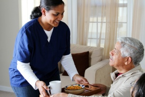 Man receiving extra care in an in home care program